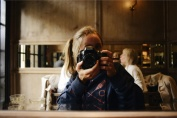 Self-portrait in a café mirror